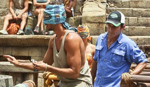 Jeff Probst watches castaways complete a challenge